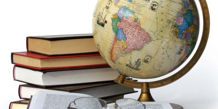 Image of globe with stack of books and one open book