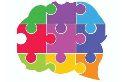 Clipart of puzzle pieces in the shape of a brain