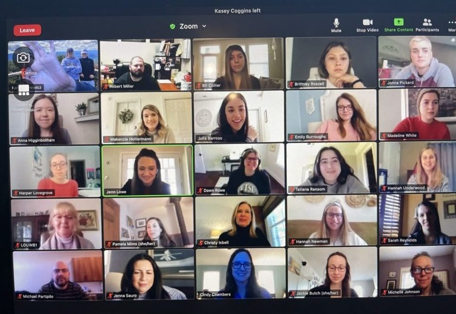 Zoom call with multiple people appearing in squares.