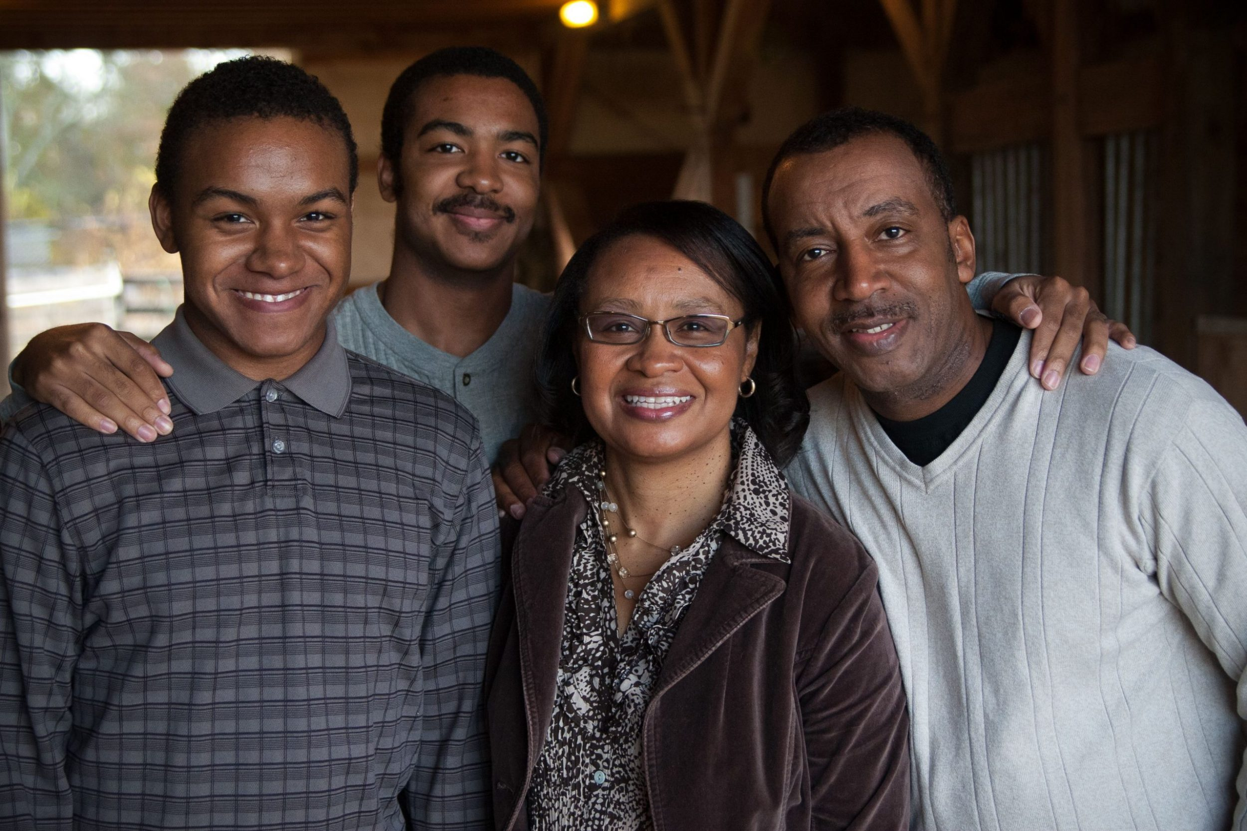 Brown Family of 4, mom, dad and 2 sons