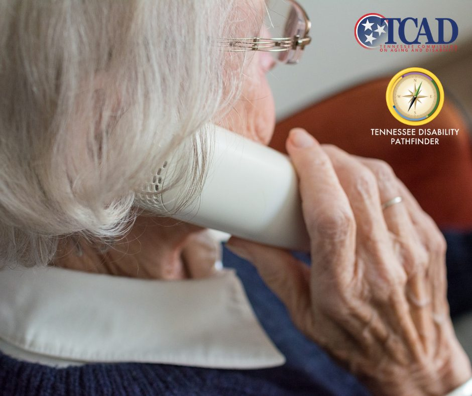 Image of older adult holding a telephone. In the top right corner of the image are the logos for Tennessee Commission on Aging & Disability and the compass logo of Tennessee Disability Pathfidner.